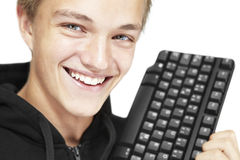 Young student. A young student with a computer keyboard Stock Photos
