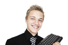 Young student. A young student with a computer keyboard Royalty Free Stock Images
