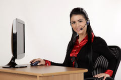 Young student. Young girl working behind the desk Stock Images