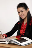 Young student. Young brunet student doing homework Stock Image