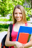 Young student. Young beautiful woman with the books outdoors Royalty Free Stock Photography