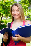 Young student. Young beautiful woman with the books outdoors Stock Photo