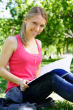Young student. Young beautiful woman with the book outdoors Stock Photos