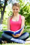 Young student. Young beautiful woman with the book outdoors Royalty Free Stock Image