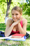 Young student. Young beautiful woman with the books outdoors Royalty Free Stock Images