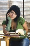 Young Student. A young student sitting on her desk with books Royalty Free Stock Photos