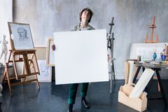 Young student artist at art workplace stock images