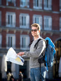 Young student backpacker tourist looking city map in holidays travel. Young attractive student backpacker tourist in Europe looking city map outdoors enjoying Stock Photos