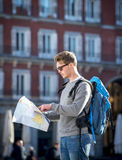 Young student backpacker tourist looking city map in holidays travel Stock Photo