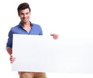Young student with a big empty sign smiling Royalty Free Stock Photography