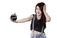Young student with bomb in studio Royalty Free Stock Photo