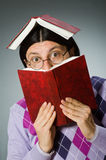 Young student with book in learning concept Stock Photos