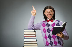 Young student with book in learning concept Stock Image