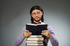 Young student with book in learning concept Stock Photo