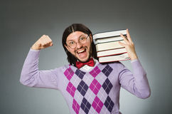 The young student with book in learning concept Royalty Free Stock Photo