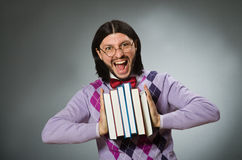 The young student with book in learning concept Stock Images