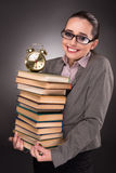 The young student with books and clock Stock Image