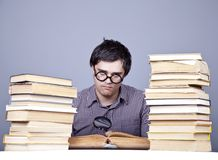 The young student with the books isolated. Stock Images