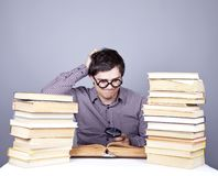 The young student with the books isolated. Royalty Free Stock Photos