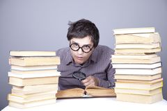 The young student with the books isolated. Stock Photos