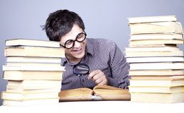 The young student with the books isolated. Royalty Free Stock Images