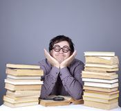 The young student with the books isolated. Royalty Free Stock Image