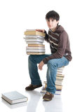 The young student with the books isolated Stock Images