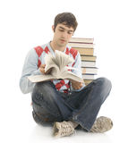 The young student with the books isolated on a whi Stock Image