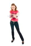 The young student with a books isolated on a white Royalty Free Stock Image
