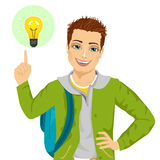 Young student boy pointing finger to light bulb having an idea Stock Image
