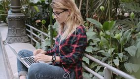 Young student or business woman works on laptop stock video footage