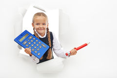 Young student with calculator and large pencil Royalty Free Stock Image
