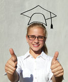 Young student in cap. Ok Royalty Free Stock Images