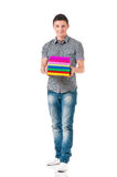 Young student carrying books Stock Images