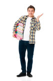 Young student carrying books Royalty Free Stock Photo