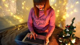 Young student chatting with group mates on holidays. Pretty girl in casual conversing with friends and congratulating on Christmas.  Cheerful teenager typing stock video footage