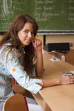 Young student in the classroom. Young student sitting in the classroom royalty free stock photography