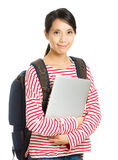 Young student with computer and backpack Stock Photo