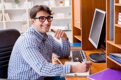 The young student at computer table Stock Photography