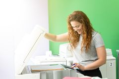 Young student at a copy center stock photo