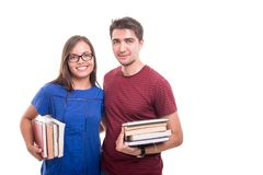 Young student couple holding bunch of books Royalty Free Stock Photo