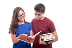 Young student couple studying together holding books. Isolated on white background with copypsace advertising area Royalty Free Stock Photos