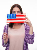 Young student covering her mouth with US flag Royalty Free Stock Photography