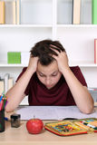 Young student desperate and overworked with homework at school Stock Photo