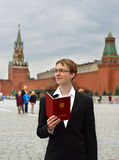 Young student with diploma in Red Square Royalty Free Stock Photography