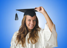 Young student with diploma on white Stock Photography
