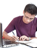 Young Student Doing Assignment Stock Image