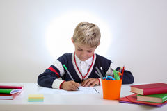Young student doing his homework Royalty Free Stock Photos