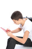 Young student doing homework Royalty Free Stock Photos