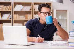 The young student drinking coffee from cup Royalty Free Stock Images